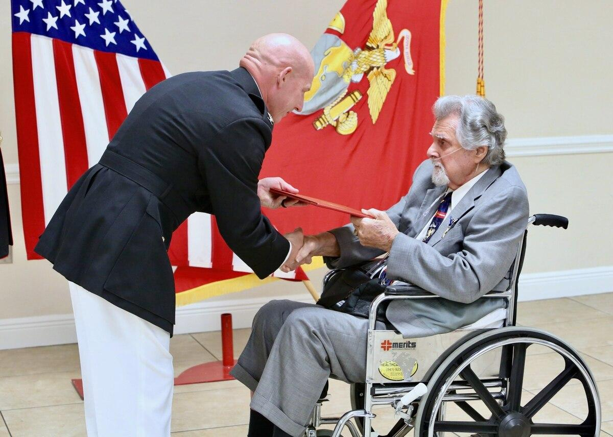 Marine Corps Col. John Polidoro, chief of staff, U.S. Marine Corps Forces Central Command, awards the Silver Star on Cpl. Salvatore Naimo, a Korean War Veteran in Sarasota, Florida, on March 17. (Gunnery Sgt. Eric Alabiso
