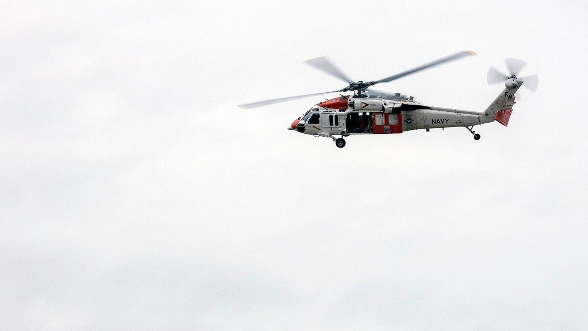 An MH-60S Seahawk helicopter assigned to Naval Air Station Whidbey Island Search and Rescue flies over Naval Station Everett during a training exercise Nov. 5, 2020. (MC3 Ethan Soto/Navy)