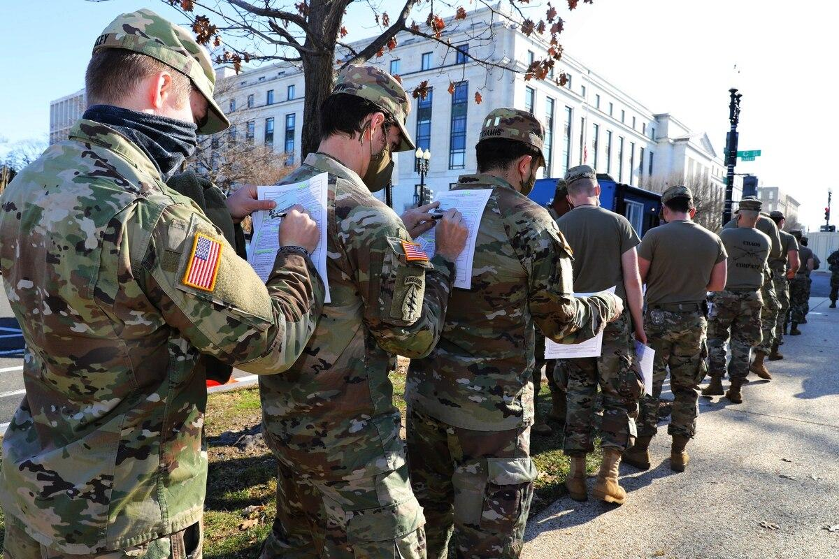 Maryland Army National Guardsmen fill out medical paperwork to receive the COVID-19 vaccine at the U.S. Capitol Complex in Washington on Jan. 14, 2021. (Sgt. Chazz Kibler/National Guard)