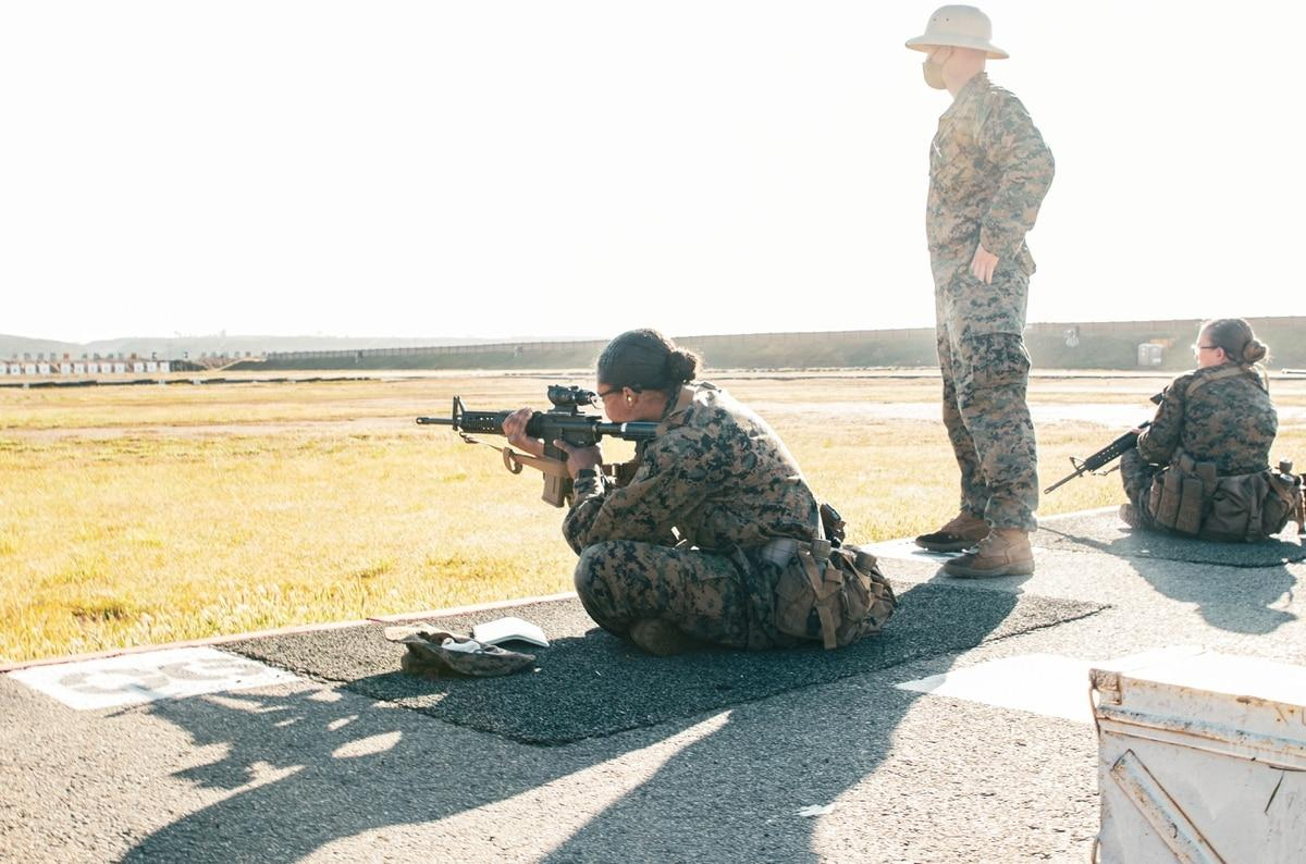 Marine Corps Recruit Jazzmin Stewart with Lima Company, 3rd Recruit Training Battalion, shoots in the sitting position during a slow-fire drill as part of the prequalifications at Edson Range aboard Marine Corps Base Camp