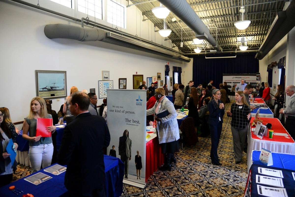 DoD is hosting its fifth annual military spouse symposium starting April 27. Pictured here, spouses interact with local employers during the career information fair segment of a spouse symposium in 2018 at Dover Air Force