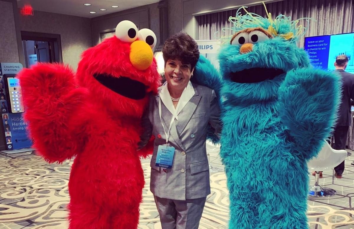 Patricia Barron, pictured here with Elmo and Rosita, was on the advisory committee for Sesame Workshop