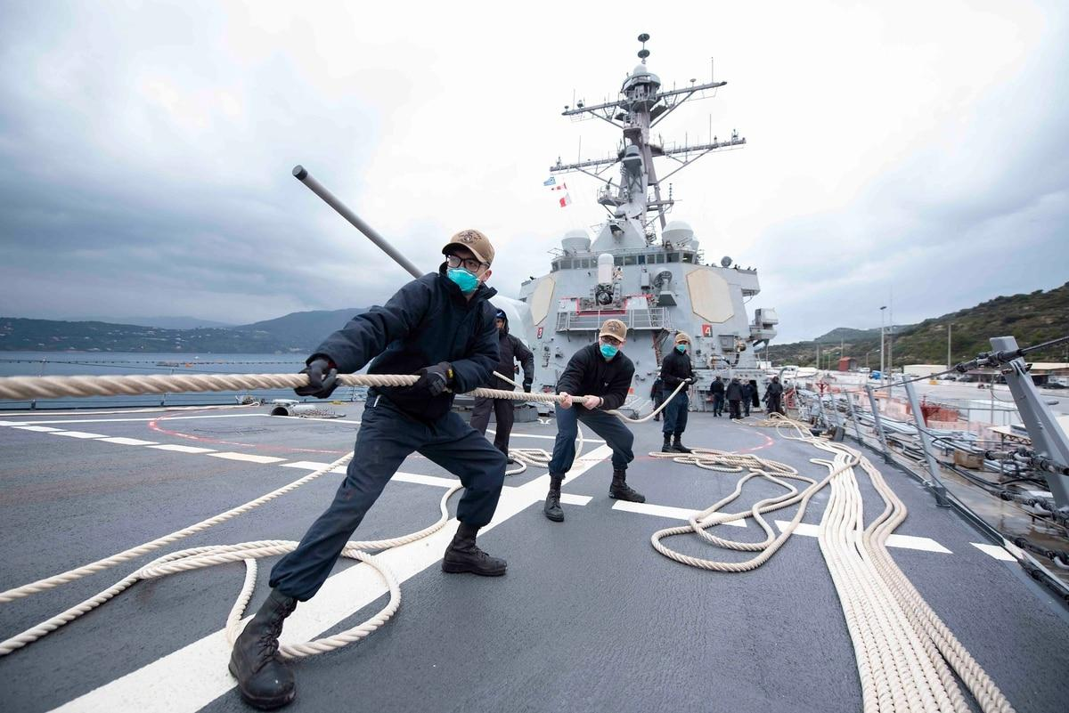 Thumbnail: Sailors heave in line as the Arleigh Burke-class guided-missile destroyer Mitscher prepares to depart Souda Bay, Greece, March 24. (MC2 Kaleb Sarten/Navy)