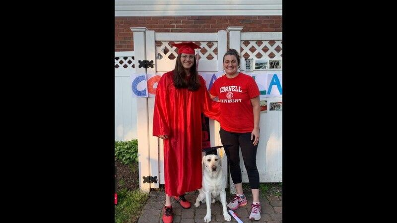 Enlarge Kim DeFiori, left, Sara Laszaic, and Thor, a PTSD service dog, on the day of Kim's grad...